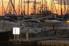 Masts of boats during a sunset in the port Royalty Free Stock Images