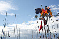 Masts and fisherman flags. Colorful fisherman flags and masts in harbour Royalty Free Stock Photography