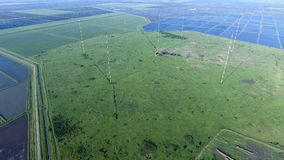 Masts longwave antennas communication among the rice fields floo. Ded. Telecommunications and communications equipment and radar Stock Image