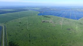 Masts longwave antennas communication among the rice fields floo. Ded. Telecommunications and communications equipment and radar Royalty Free Stock Photos