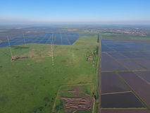 Masts longwave antennas communication among the rice fields flooded Stock Photo