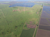 Masts longwave antennas communication among the rice fields flooded Royalty Free Stock Images