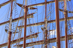 Masts. Maritime background with masts, rigging and sails of old sailing ships in front of a blue sky stock photos