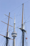 Masts Of Of Sailing Boat And CN Tower Royalty Free Stock Photos