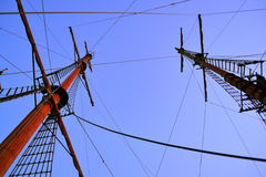 Masts of the old sailing ship at dusk. Masts of old sailing tall ship at dusk - horisontal photography stock photo