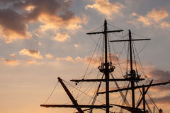 Masts of a pirate ship. On sunset stock photo