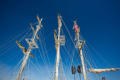 Masts of a replica of a sailing boat with speakers Royalty Free Stock Photos