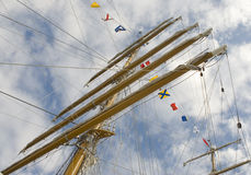 Masts and rigging. With nautical signal flags Stock Photos