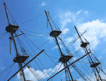 Masts and rigging of a old sailing ship over blue sky Stock Image