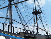 Masts and rigging of a old sailing ship over blue sky Royalty Free Stock Images