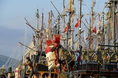 Pirate sail vessel. Masts and rigging on a pirate sail vessel with Turkish flags on blue sky background Stock Images