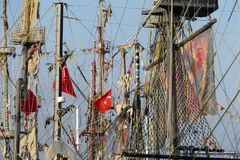 Pirate sail vessel. Masts and rigging on a pirate sail vessel with Turkish flags on blue sky background Royalty Free Stock Photos