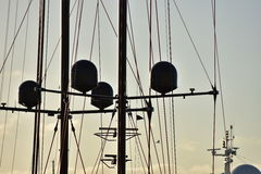 Masts and ropes in evening light Stock Photography