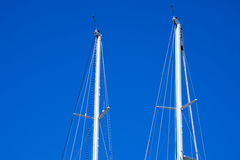 Masts of Sailboats Against a Blue Sky Stock Images
