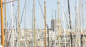 Masts of sailboats in the port of Marseille Stock Photos