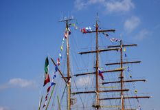 Masts of a sea ship. Masts of a sailing ship against the blue sky stock photography