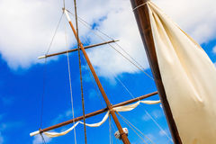 Masts of sailing ships lying at the wharf skyline. Blue sky with clouds Stock Images
