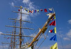 Masts of a sea ship. Masts of a sailing ship against the blue sky stock images