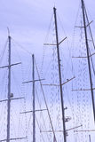 Masts of ships and. Sailboats against the sky Stock Photos