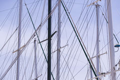 Masts of ships and. Sailboats against the sky Stock Image