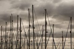 Masts and Stormy Sky Stock Images