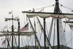 Masts of a tall ship. These are the masts and folded sails of the Nina and the Pinta, reproductions of two of Columbus` ships used to sail to the Americas in stock photo