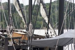 Masts of a tall ship. These are the masts and folded sails of the Nina and the Pinta, reproductions of two of Columbus` ships used to sail to the Americas in stock image