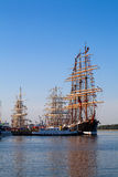Masts of Tall ships in port. Tall ships masts in early morning clear sky Stock Photo