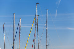 Masts of yachts on blue sky background Royalty Free Stock Photos