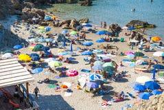 Masua Beach, Italy - August 19: Masua Beach in Nebida crowed in Royalty Free Stock Photo
