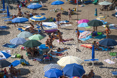 Masua Beach, Italy - August 19: Masua Beach in Nebida crowed in. Summertime seen from the top eith blue sea on August 19.2013 in Masua, Italy as editorial Royalty Free Stock Images