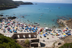 Masua Beach, Italy - August 19: Masua Beach in Nebida crowed in Stock Photo