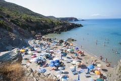 Masua Beach, Italy - August 19: Masua Beach in Nebida crowed in Royalty Free Stock Photos