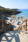 Masua Beach, Italy - August 19: Masua Beach in Nebida crowed in Stock Photo