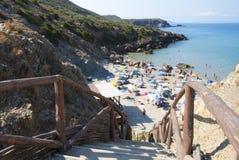 Masua beach in Sardinia island, crowd in summer sunny day. Focus Stock Photos