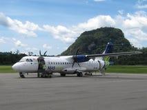 MASwings turboprop plane. Mulu, Borneo, Malaysia - September 2013: MASwings ATR-72 plane unloaded on the Mulu airstrip in Malaysia stock image