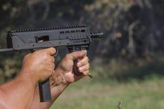 Maszynowego pistoletu żywy ogień Fotografia Stock