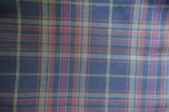 Matéria têxtil da manta em cores deprimidos de cima de Fotos de Stock