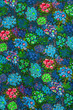 Matéria têxtil, flores coloridas Imagem de Stock