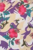 Matéria têxtil, flores em um fundo pálido Imagens de Stock Royalty Free