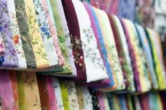 Matéria têxtil no indicador Imagem de Stock Royalty Free
