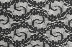 Matéria têxtil preta do laço foto de stock