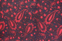 Matéria têxtil vermelha e preta com teste padrão de paisley Imagem de Stock