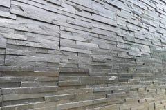 Matériaux extérieurs populaires de décoration de forme noire de mur en pierre images stock