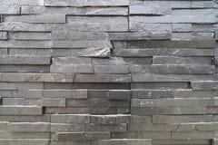 Matériaux extérieurs populaires de décoration, pierre noire un grand choix de tailles, populairement disposées dans les couches photo libre de droits