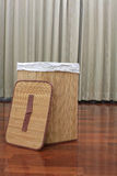 Mat basket with cover on the wooden floor Stock Photo