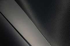 Mat carbon wrapped car. Black mat carbon wrapped washed car Stock Image