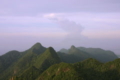 Mat Cincang Mountains at Dusk. Ancient and rugged tropical mountains of Langkawi Island, Malaysia royalty free stock photo