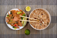 Mat with cooked rice and meat with vegetables. Cooked rice and meat with vegetables on mat Stock Images
