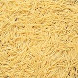 Mat för bakgrund för pastavermicellertextur traditionell italiensk Arkivfoto